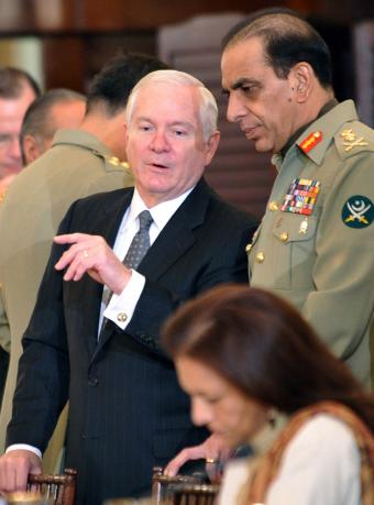 The secretary of the U.S. Defense Robert Gates talks with General Pervez Kayani, yesterday in Washington.