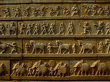 This relief shows a procession of soldiers and merchants, a sign of prosperity of the Empire.